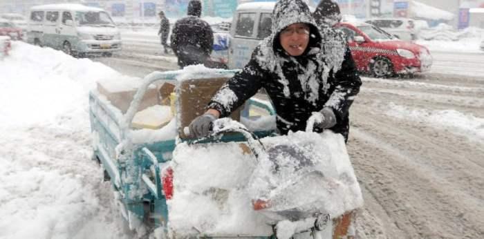 снег китай