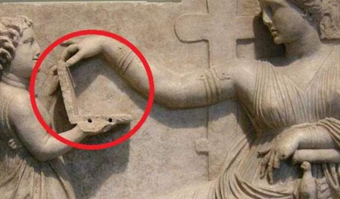 статуя ноутбук
