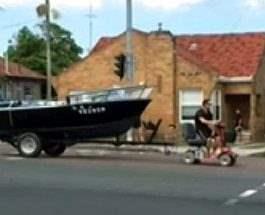 буксировал лодку