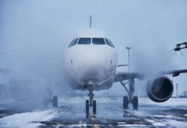 самолет снег