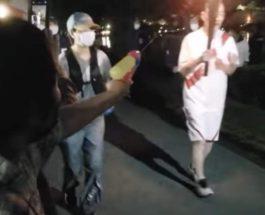 Токио, Олимпийский огонь, женщина, пистолет,